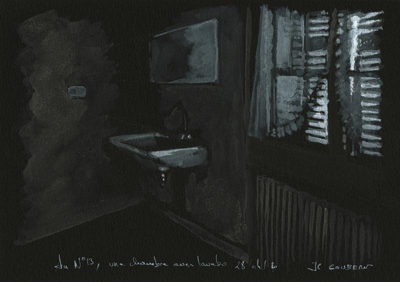 Une chambre avec lavabo